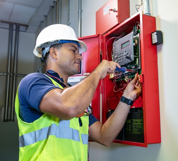 man from wiginton installing fire suppression system